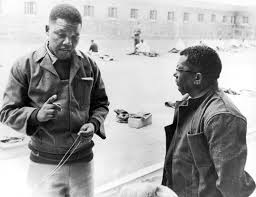 Rare photo of Mandela with fellow prisoner and ANC leader Walter Sisulu in the Robben Island prison yard in 1966