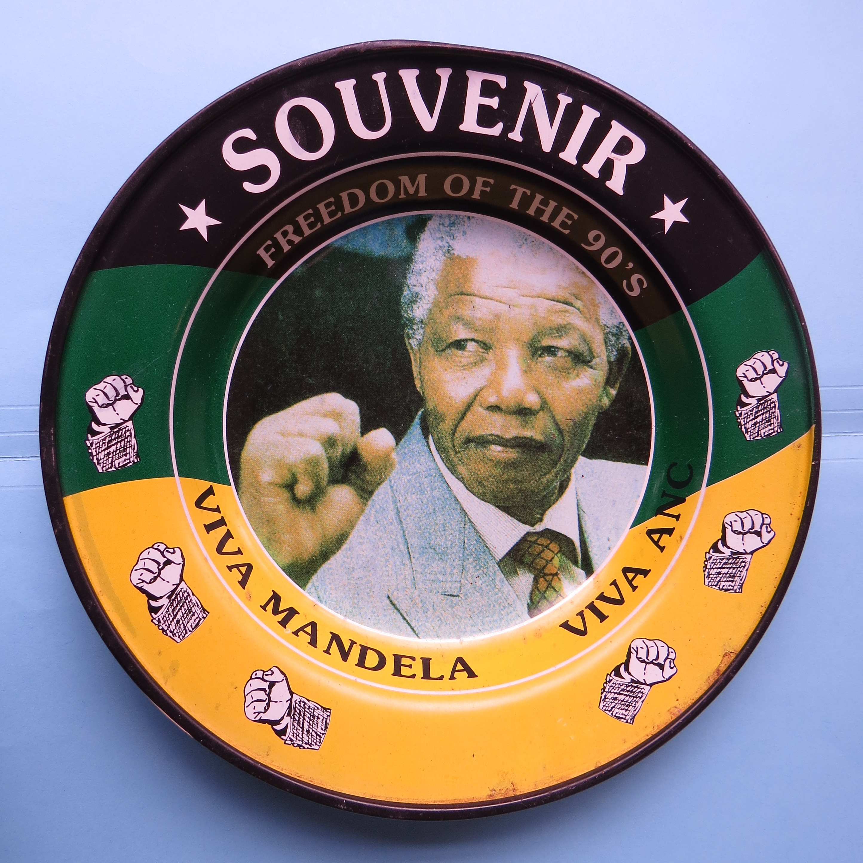 Commemorative tin plate sold by street vendors at Mandela's 1994 presidential inauguration