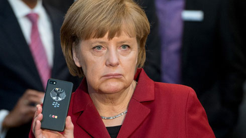 German Chancellor Angela Merkel looking none too happy with the NSA bugging her phone