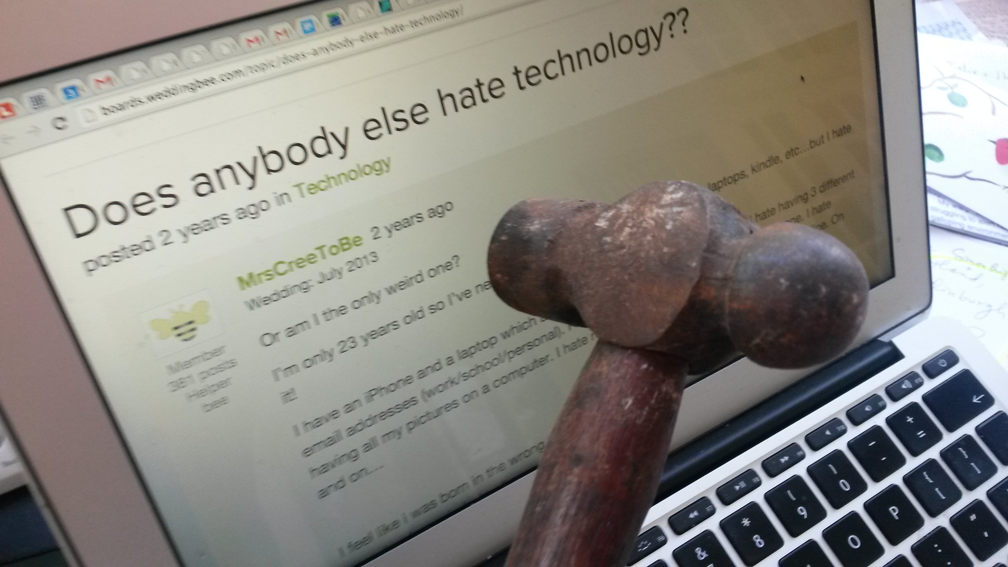 Luddite holds hammer ready to smash laptop