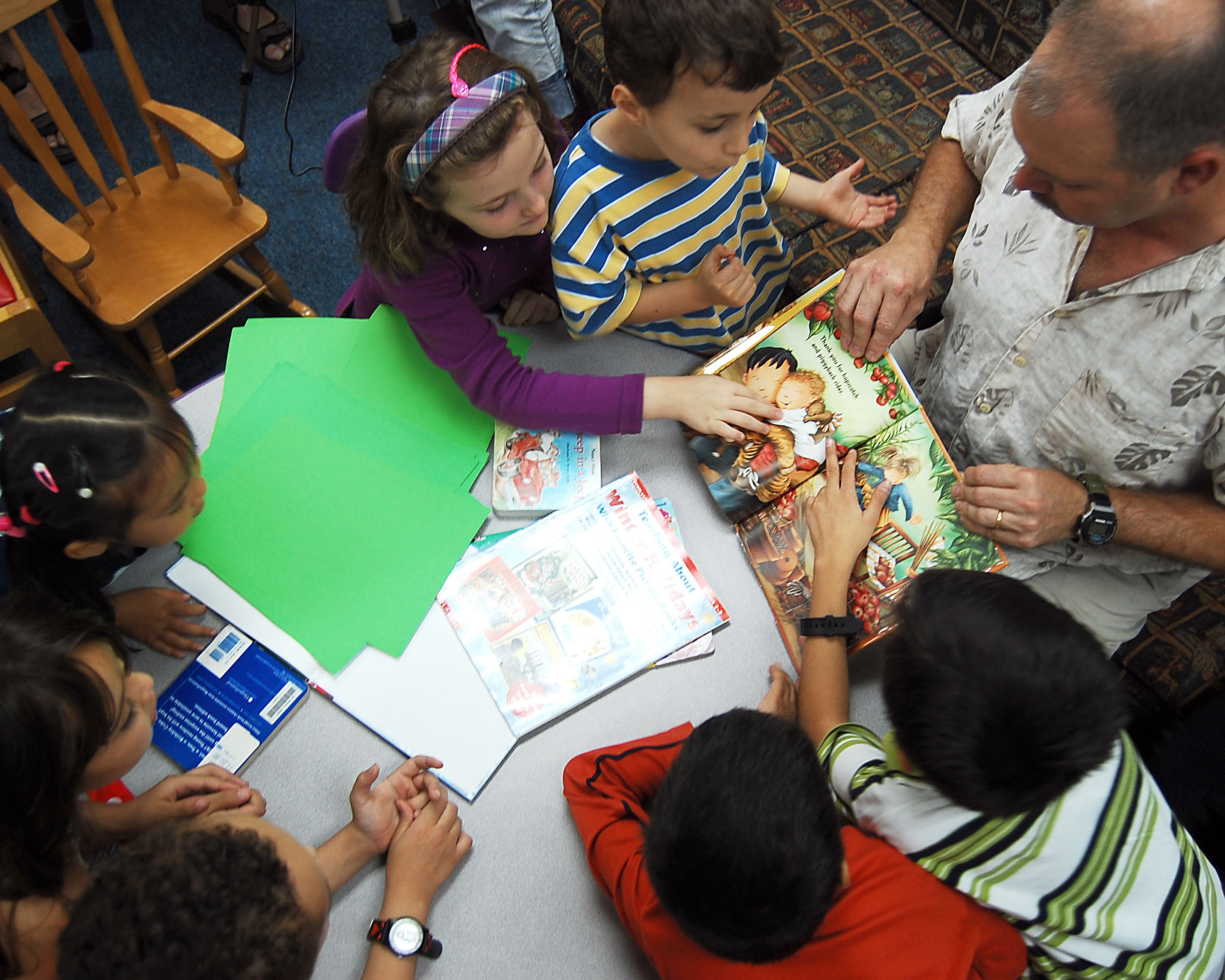 older person reading to children
