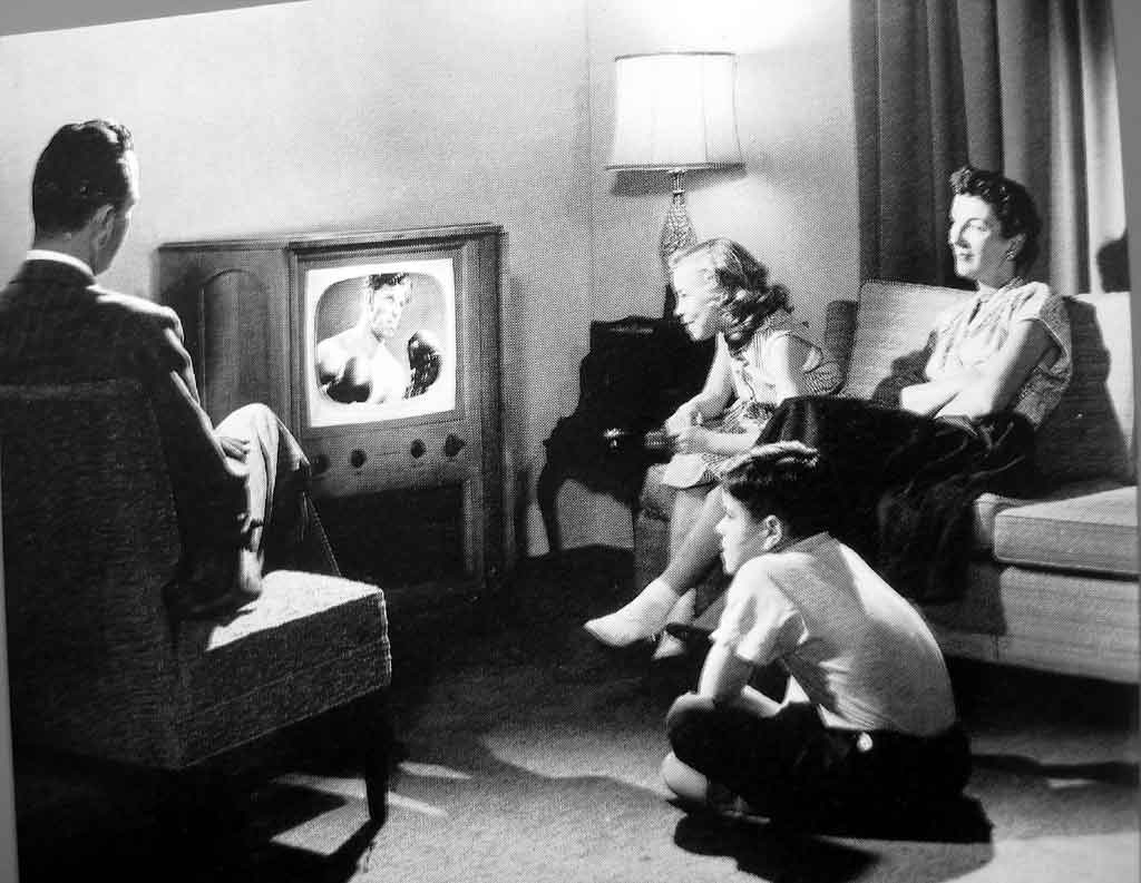 Family in 1950s watching TV together