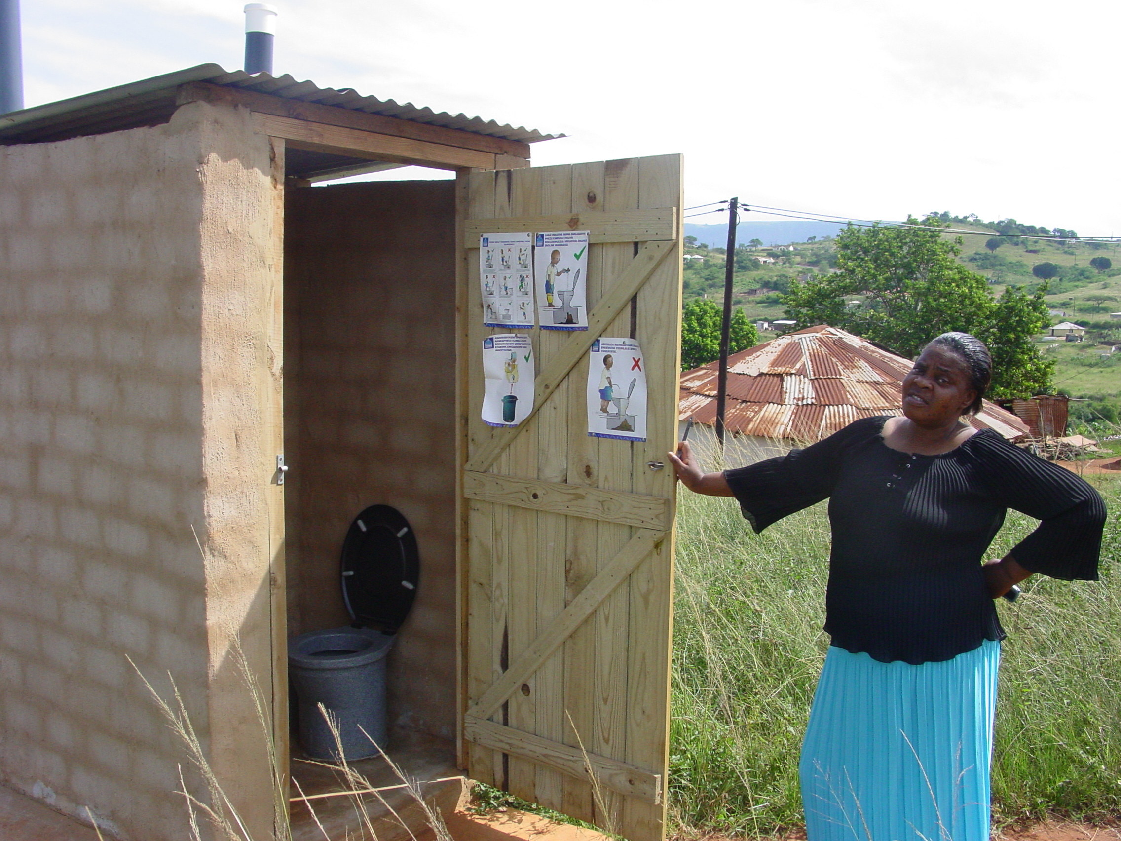 Outside non-flushing toilet still used widely in Africa so must go outside when waking at night to use the toilet
