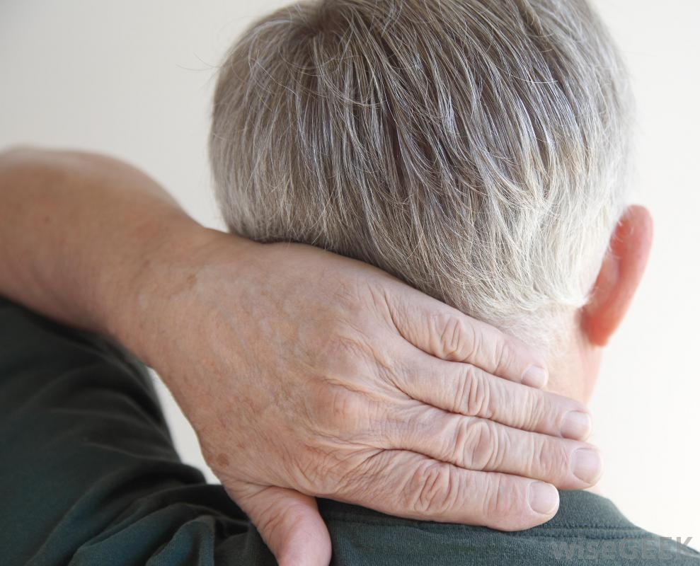 older man holding neck in pain