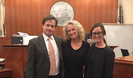 Patricia (Trish) Williams with her attorneys Chris Dolan and Anne Costin