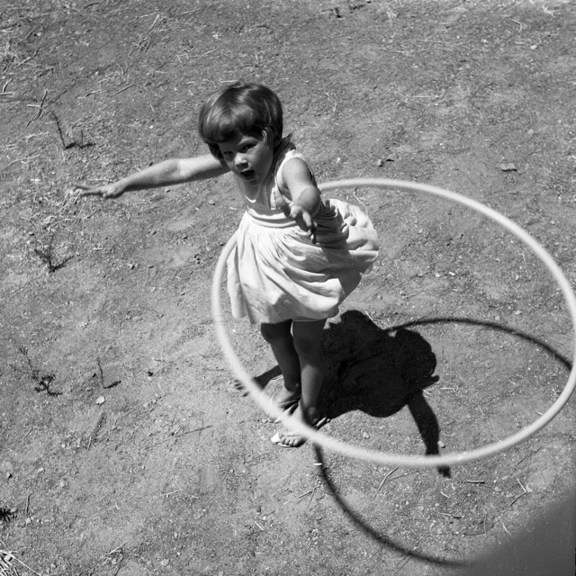 Girl twirling hula hoop, 1958