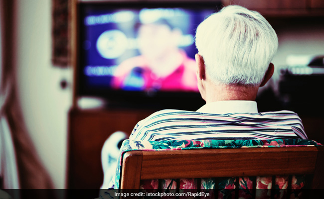 older person watching TV